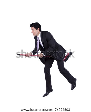 Young businessman flying a broom (isolated on white)