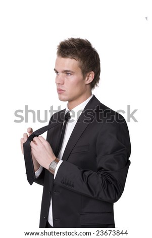 Young businessman focussed while dressing