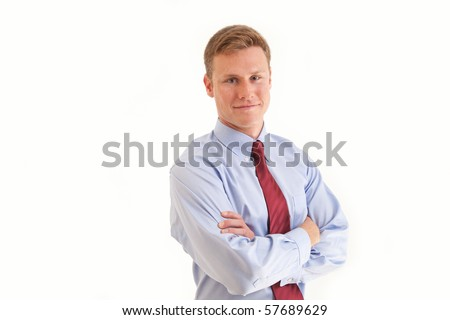 Young businessman folding arms across chest - stock photo