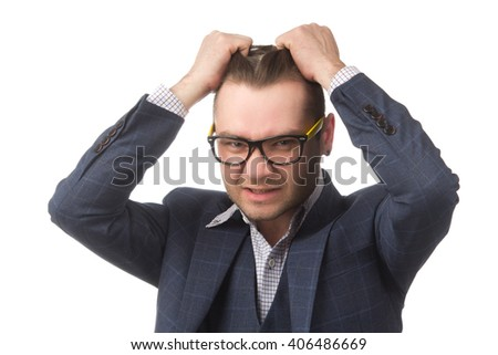 Young businessman frustrated, isolated on white background - stock photo