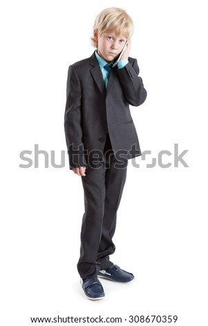 Young businessman full-length in suit talking with mobile phone, isolated on white background - stock photo