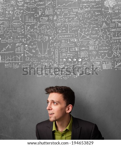 Young businessman gesturing with sketched charts over his head - stock photo