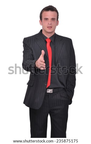 Young businessman gives his hand in order to shake hands with someone - stock photo