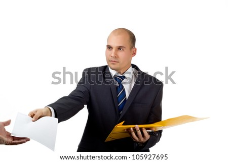 Young businessman giving some work related papers to another person - stock photo
