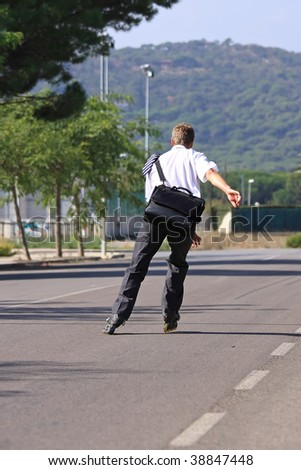 Young businessman go to work with a roller skate - stock photo