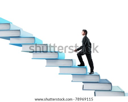 young businessman going up on 3d book stair - stock photo