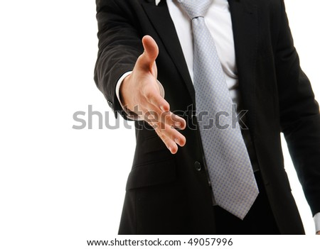 Young businessman greeting with handshake isolated on white - stock photo