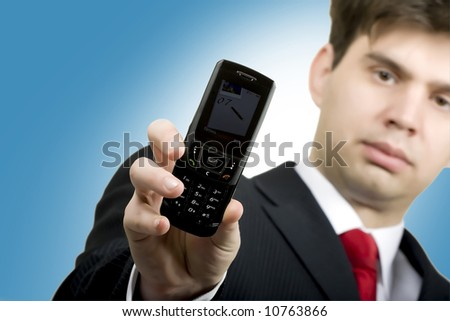 Young businessman handsome with phone organizer - stock photo