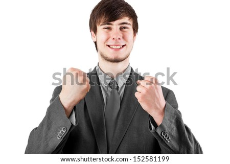 Young businessman happy and Cheers - stock photo