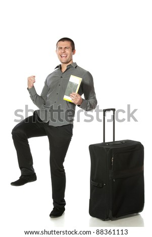 Young businessman happy because of the following trip isolated on white background - stock photo