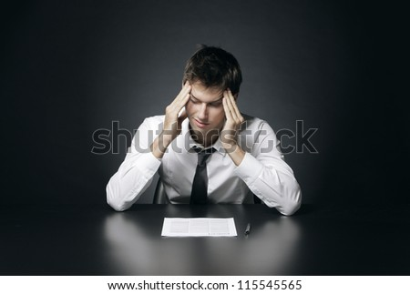 Young businessman has the headache