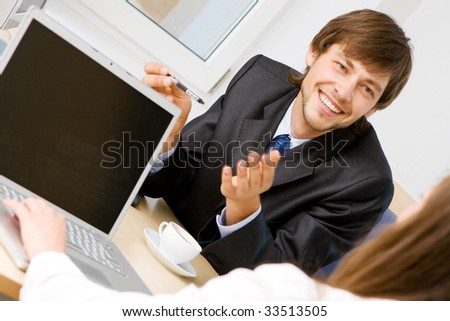 Young businessman having a conversation - stock photo