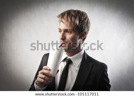 Young businessman having a drink - stock photo