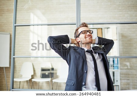 Young businessman having a little rest after work in office - stock photo