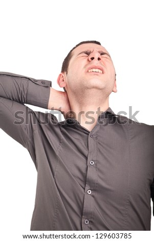 Young businessman having neck pain - stock photo