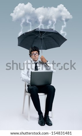 Young Businessman having problems with cloud computing technology