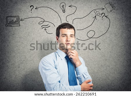 Young businessman having some ideas in his head - stock photo