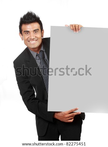young Businessman holding a blank sign isolated over white background - stock photo
