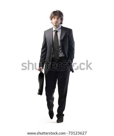 Young businessman holding a briefcase - stock photo