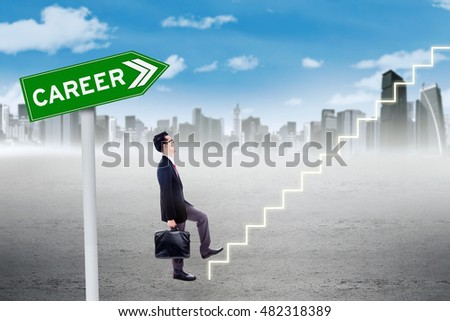 Young businessman holding a briefcase and climb a staircase with career word on the signpost