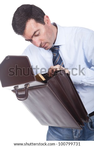 young businessman holding a briefcase and putting documents inside - stock photo