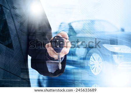 Young businessman holding a car key