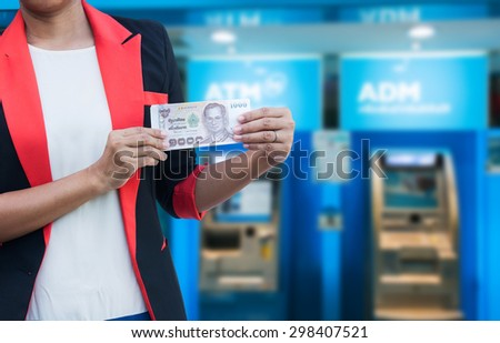 Young businessman holding a Cash ATM machine. - stock photo