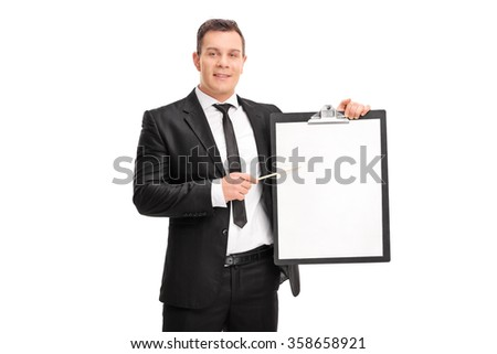 Young businessman holding a clipboard with a blank paper on it and pointing towards it with a stick isolated on white background - stock photo