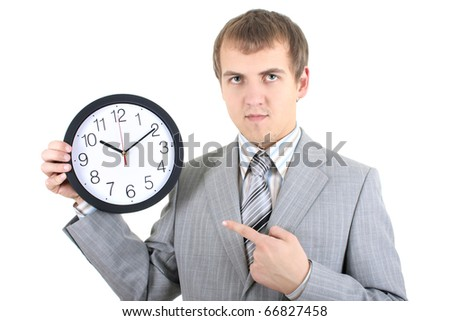 young businessman holding a clock over white