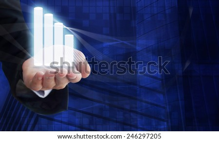 Young businessman holding a 3D graphic in his hand