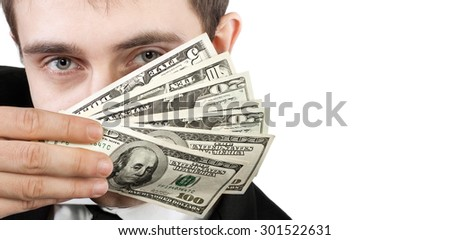 Young businessman holding a fan of dollar bills near the face isolated on white background with copy-space