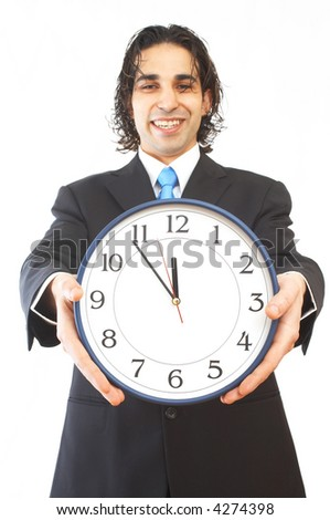 young businessman holding a modern clock