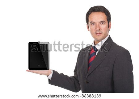 young businessman holding a tablet computer on his hand - stock photo