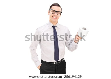 Young businessman holding a toilet paper roll and posing isolated on white background - stock photo
