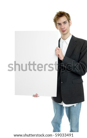 Young businessman holding a white cardboard sign with copyspace while standing up