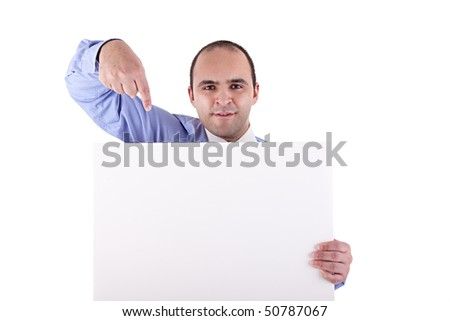 Young businessman holding a whiteboard and pointing, looking at the camera, isolated on white background - stock photo