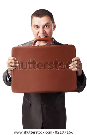 young businessman holding brief case in teeth isolated on white background - stock photo