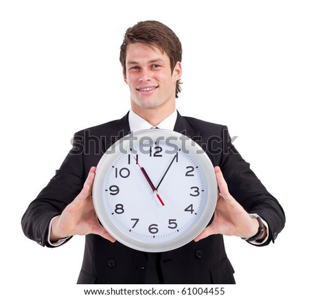 young businessman holding clock over white