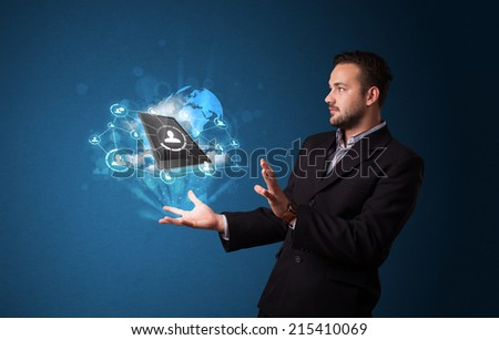 Young businessman holding cloud technology in his hand