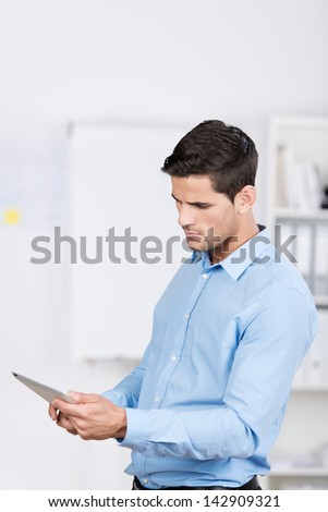 Young businessman holding digital tablet in office - stock photo