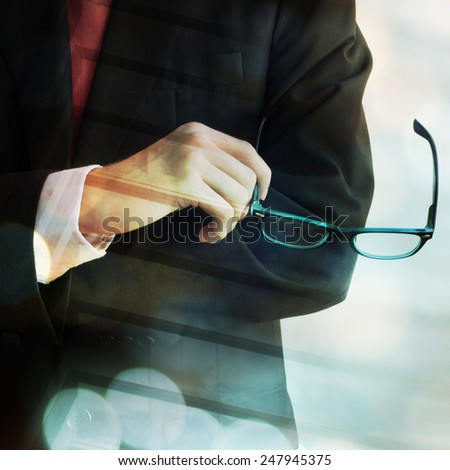 Young businessman holding glasses - stock photo