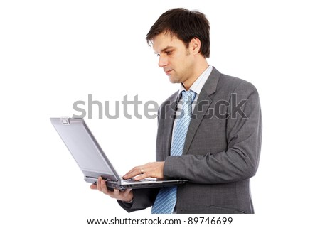 Young businessman holding laptop isolated on white background