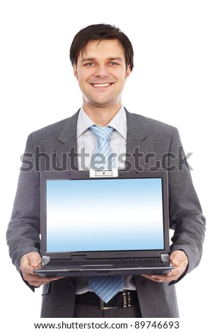 Young businessman holding laptop with copyspace on the screen