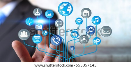 Young businessman holding modern digital electronic circuit with icons in his hand