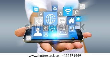 Young businessman holding modern digital icon application over his mobile phone '3D rendering' - stock photo