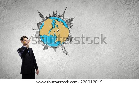 Young businessman holding paint brush in hand - stock photo