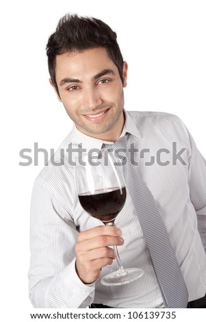 Young businessman holding red wine glass isolated on white background. - stock photo