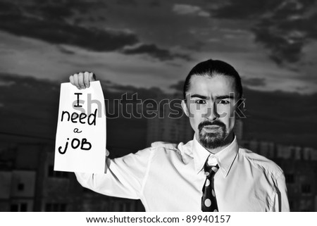 "Young businessman holding sign ""I need a job"" - stock photo"