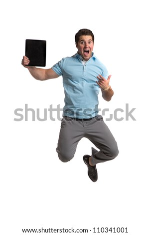 Young Businessman Holding Tablet PC Jumping cheerfully on Isolated White Background - stock photo