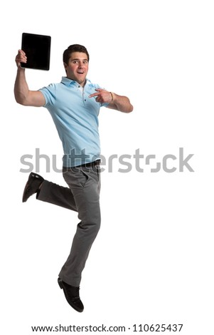 Young Businessman Holding Tablet PC Jumping cheerfully on Isolated White Background